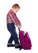 Little boy with heavy schoolbag