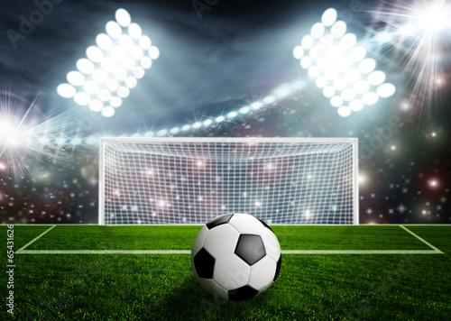 Plexiglas Stadion Soccer ball on green stadium arena