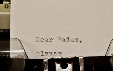 Text Dear madam typed on old typewriter