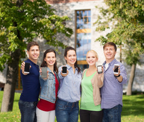 students showing blank smartphones screens