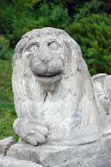 Stony chapped figure of lion at entrance to Olesko Castle