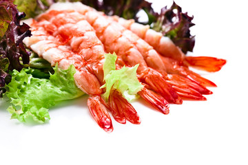 Shrimp with salad leaves on white background