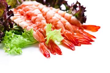 Shrimp with salad leaves on white background