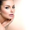 Beauty Spa Woman Portrait. Beautiful Girl Touching her Face