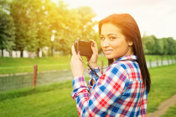 Young female photographer in nature