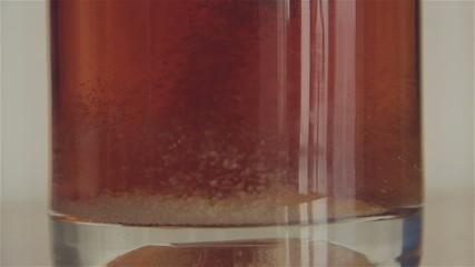 Stirring sugar in tea cup, English breakfast, with sound