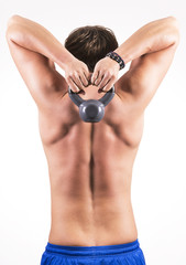 Fitness man doing exercise with kettlebell.
