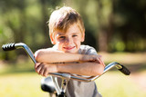cute little boy on a bicycle