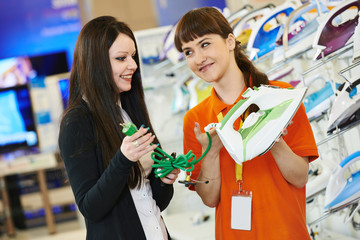 woman shopping at home appliance supermarket