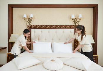 chambermaid woman team at hotel service