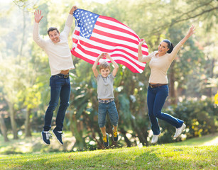 american family jumping with USA flag