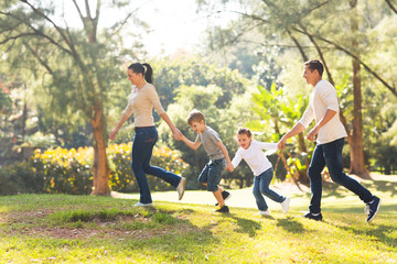 family running in forest