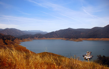 Boat on the blue lake in the mountains of California.