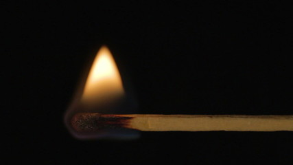 Wooden match burning horizontal, fire spreads left right sound