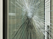 smashed glass window pane - 65441623