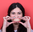 Portrait of happy woman with healthy smile holding denture again