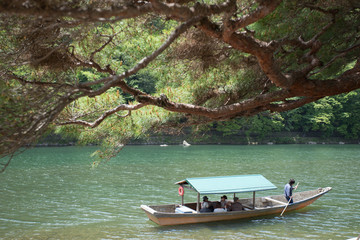 The Katsura shore with rowing boat in Arashiyama, Kyoto, Japan