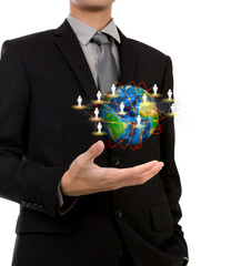 Business man holding the small world of social network in his ha
