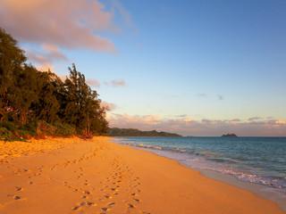 Gentle waves crash on Waimanalo Beach on Oahu, Hawaii at dawn