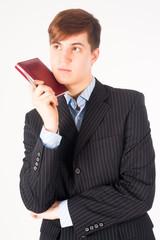 businessman holding diary log