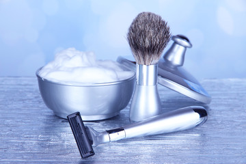 Male luxury shaving kit on table on bright background