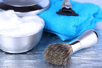 Male luxury shaving kit with towel on gray background