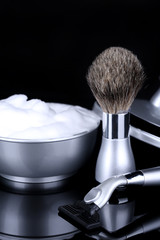 Male luxury shaving kit isolated on black