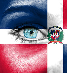Woman face painted with flag of Dominican Republic