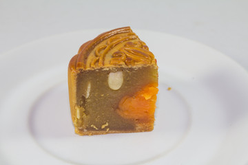Sliced of mooncake on white plate