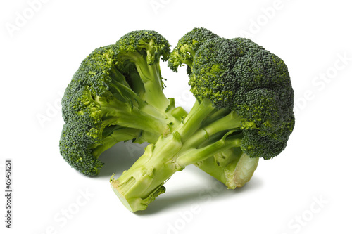 Two broccolies on white
