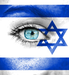 Woman face painted with flag of Israel