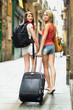 Two beautiful women with luggage