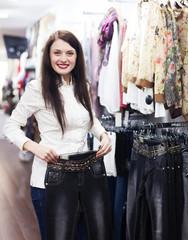Girl choosing jeans