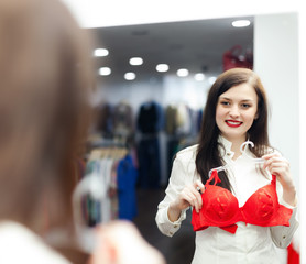 Brunette  girl choosing  bra at  store
