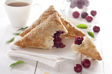 Puff Cherry Turnovers on table