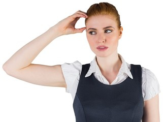 Thinking redhead businesswoman scratching head