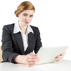 Redhead businesswoman using her tablet pc