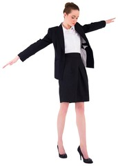 Businesswoman performing a balancing act