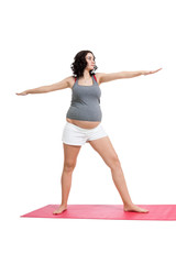 Pregnant woman doing aerobics exercises
