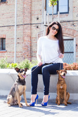 Beautiful woman with dogs