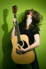 Rock woman enjoying guitar