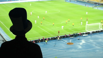Dangerous football attack, fan high cylinder hat shouting team