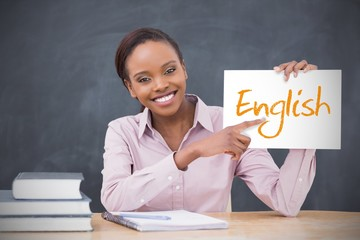 Happy teacher holding page showing english