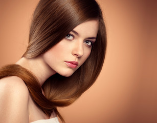 Beauty salon model with perfect long brown hair in studio