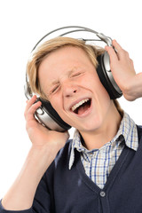 Cheerful teenage boy enjoy music from headphones