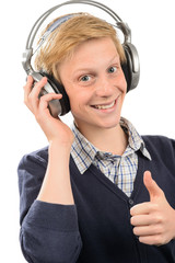 Happy teenage boy with headphones thumb-up