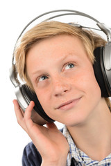 Thoughtful teenage boy listening to music