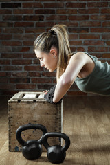 beautiful fit woman pushing up on brick background