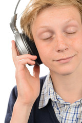Relaxed teenage boy enjoying music