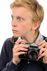 Shocked teenage boy holding retro camera